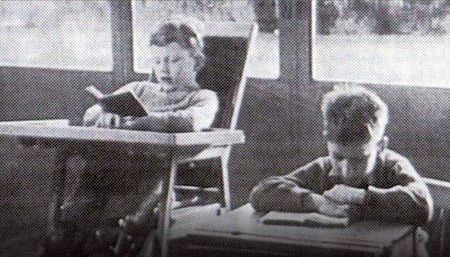 black and white photo from the 1950s of of two young schoolboys