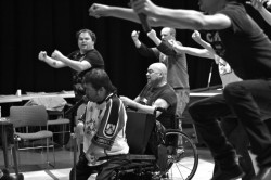 black and white photo of the cast of Reasons to be Cheerful in rehearsal