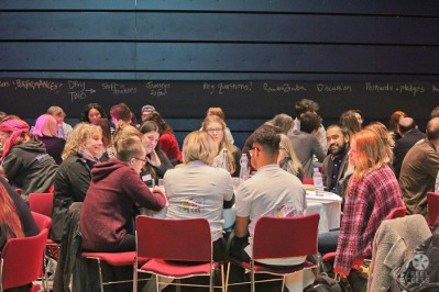 A photograph taken from the Is that all there is conference depicting delegates taking part in a workshop exercise.