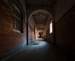 image of a long, dark, victorian corridor