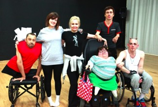 photo of six disabled performers during rehearsals