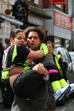 photo of live artist noemi lakmaier being carried down the street by an athlete