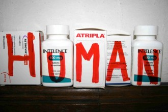 series of medication bottles and boxes with the word 'human' painted on them in red