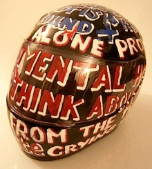 a photo of a motorbike crash helmet covered with words