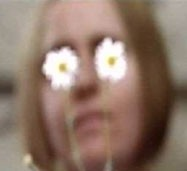 Alison Jones, image of the artist with daisies in fron of her eyes, still from the artist