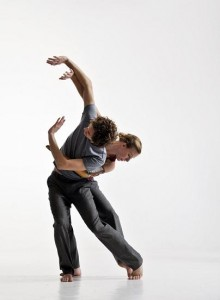 photo of two dancers posing against a white background