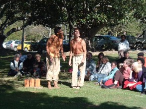 A photograph of a performance of Clive Essame's Impisi in Grahamstown in South Africa featuring performers Sdumo Mtshali and Ellis Pearson