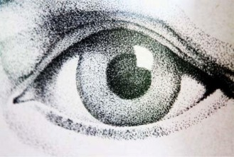 close up of an eye from a pen and ink portrait on paper