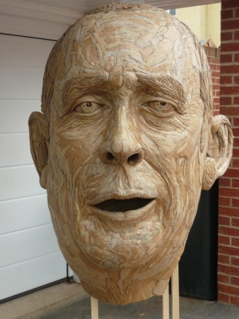 Large cardboard sculpture of male face