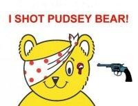 cartoon of a yellow bear with a spotty bandage and a smile - with a gun pointing at its head
