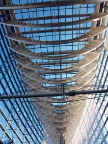 In this photograph, looking up at blue sky from the inside of Vinoly's glass atrium one gets a magnificent view of the curved white steel beams that give this space a hint of the nautical