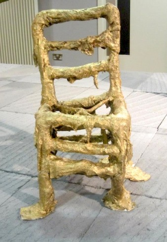 photo of a gold chair which has the appearance of melting