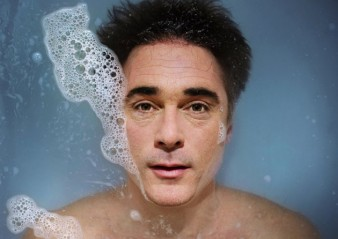 poster image for Kill Me Now with greg wise's face pictured in a bath with bubbles emerging from his lips