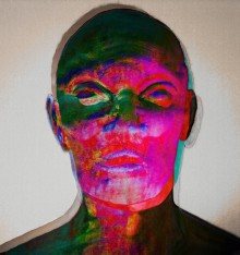 Portrait of the soft sculpture figure where Photoshop has enabled rich green, purple-pink, blue and yellow colours and a quirky misalignment of layers