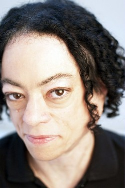 Photograph of Liz Carr by Graeme Cooper. Liz is looking directly at the camera.