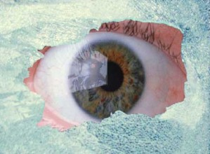 Eye looking through shattered glass