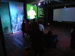 photo of an audience inside a film installation
