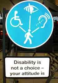 Image of a road sign with disability symbols and text that reads Disability is not a choice, your attitude is