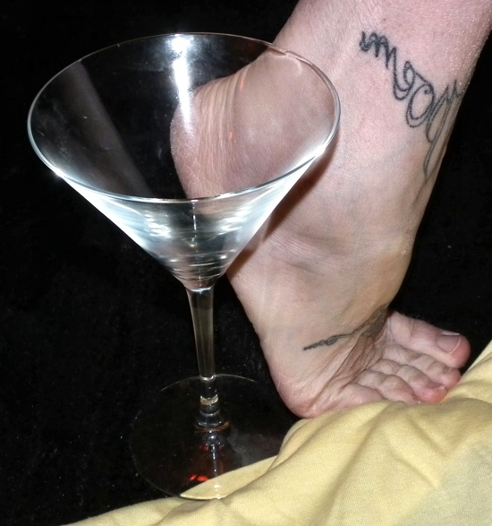 photo of a foot next to a fluted wine glass