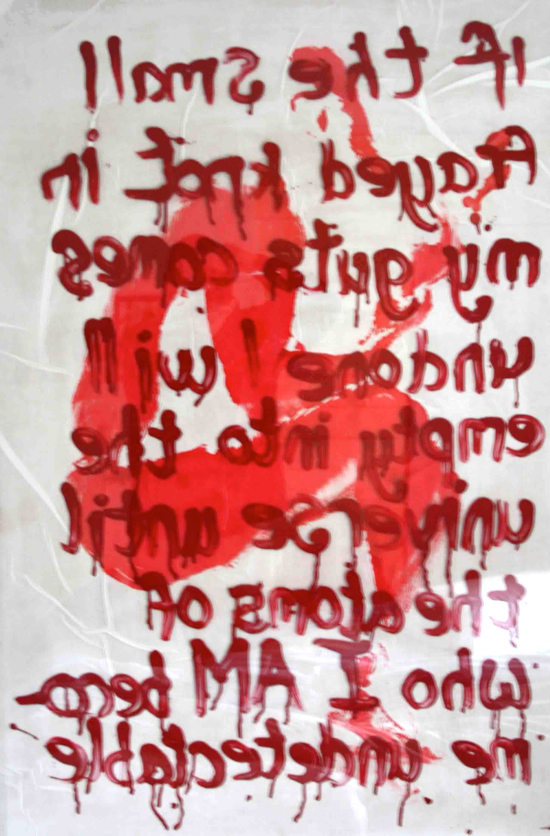 a mirror image of blood red writing on white paper