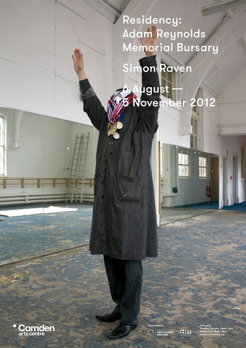 image of a man with arms in the air wearing a long coat. The man has no head.