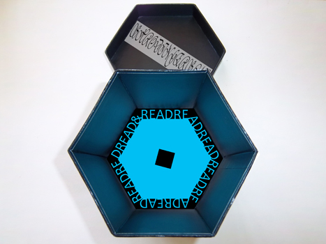 This is the black box with the lid removed so that you can see both the wording at the bottom of the box and the words inside the lid.