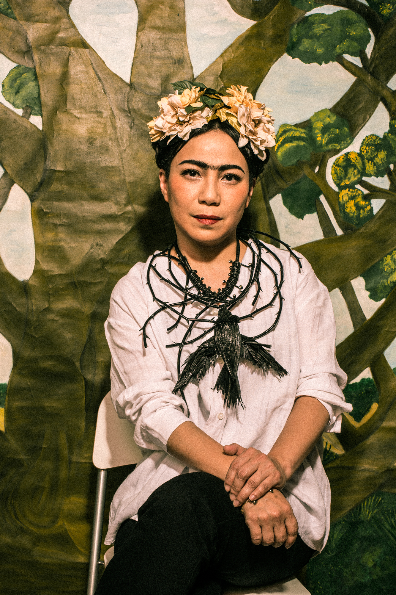 Bobo Fung in publicity material for 'The 9 Fridas', wearing a necklace of a dead hummingbird from Kahlo's self-portrait 'A Necklace of Thorns'
