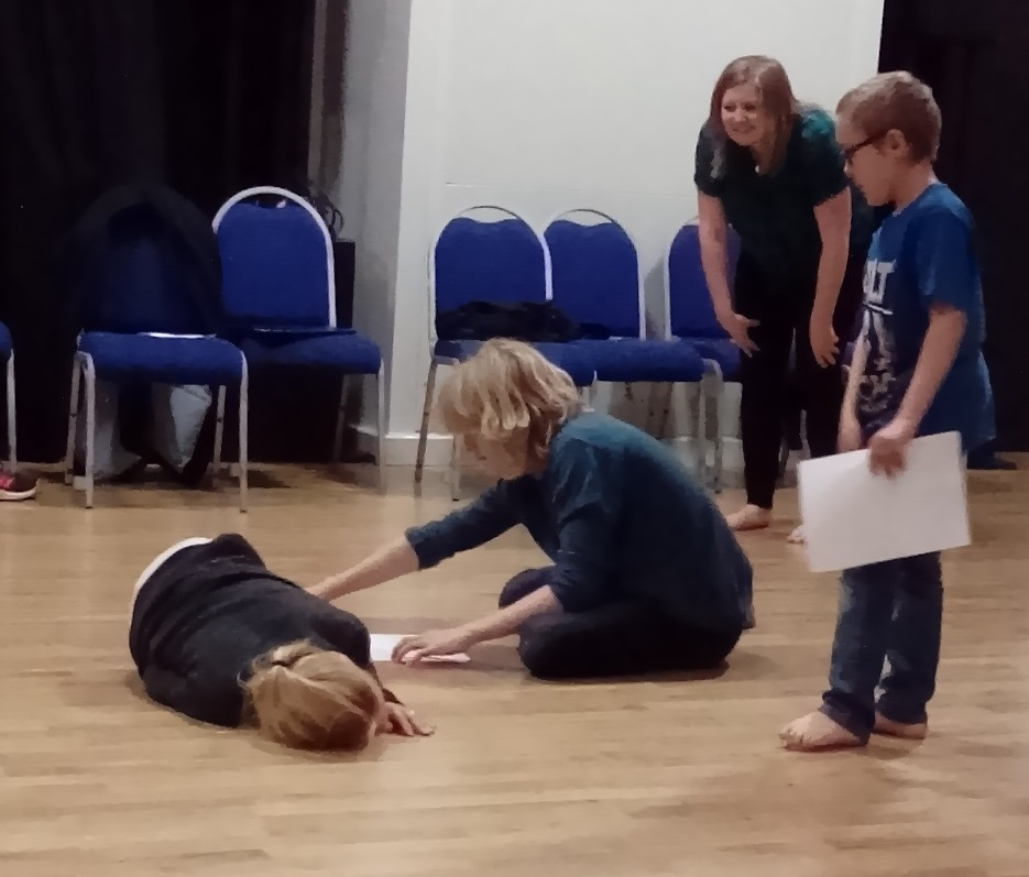 Photograph of a three children taking part in a drama workshop based on Clive Essame's play, Impisi