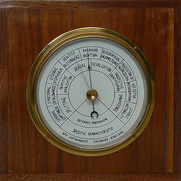This is a beautifully presented wood and brass case housing a doctored barometer. the new face lists states of mind which may relevant to mental health, the needle points to 'paranoid ideation'
