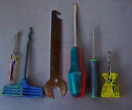 A row of tools: screwdrivers, spanner etc.