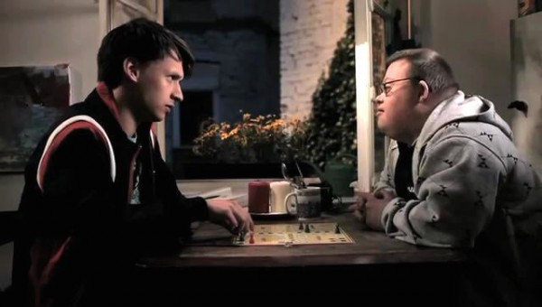 A still from the film '46/47' showing two men facing each other across a table