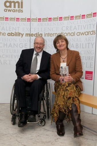 photo of male wheelchair user and seated woman at the AMI awards ceremony