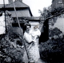 old black and white photo of a woman holding a baby