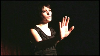 stil of star of My Song, Lara Steward holding her right hand in the air