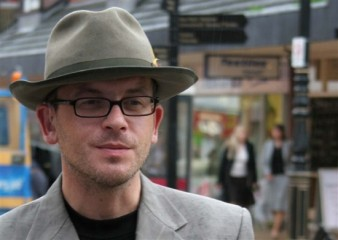 photo of actor wearing a trilby hat