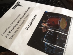 Image of event programme reads: DaDaFEst 2012 presents an evening with Evelyn Glennie Saturday 18 August, 7:30pm with an image of Evelyn Glennie beating the drums at the Olympic Opening Ceremony 2012