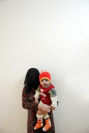 photo of woman in a veil holding a young child