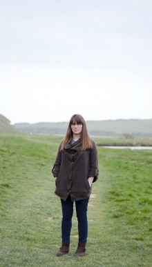photo of artist Lynn Weddle, photographed on a path in the countryside