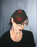 A self-portrait of the artist Natalie Papamichael wearing glasses.