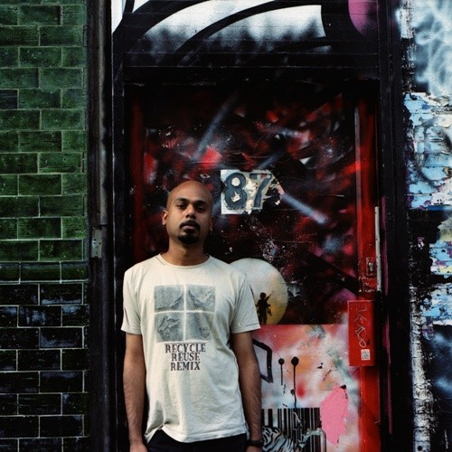 a photo of a man who leans in a door way and is surrounded by graffiti