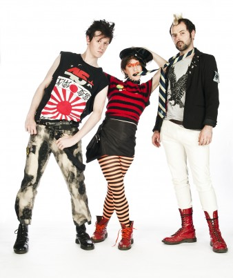 three young actors stand posing in punk clothes