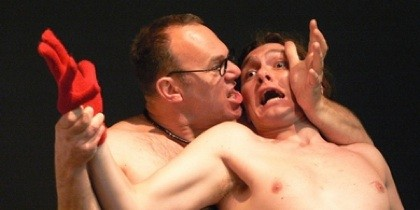 photo of two male actors in an embrace