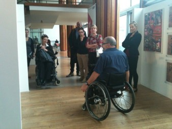 Tony Heaton addresses visitors to the exhibition