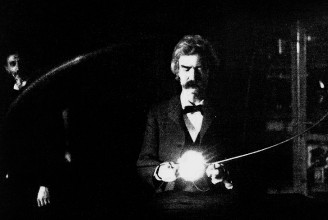 Mark Twain (penname of Samuel Langhorne Clemens) in the lab of Nikola Tesla, spring of 1894. Clemens is holding Tesla's experimental vacuum lamp, which is powered by a loop of wire which is receiving electromagnetic energy from a Tesla coil (not visible).