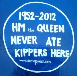 blue plaque reading HM The Queen Never Ate Kippers Here