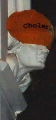 a knitted hat on a plaster head