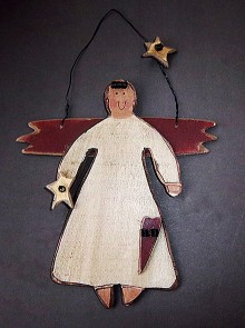 A simple, childlike, flat wooden angel painted slightly off white, with rust red wings and coiled black wire hair and hanging loop