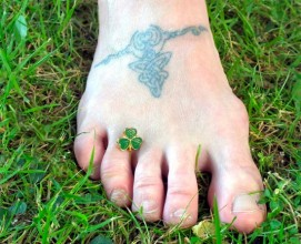 photo of the writers foot with a shamrock pendant between her toes
