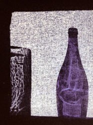 composition with smoky glass vessel and wine bottle seen through a window