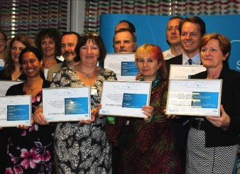 a photo of a group of people holding up awards given in Innovation, Diffusion and Excellence in Healthcare Education and Training by the  the South London Membership Council